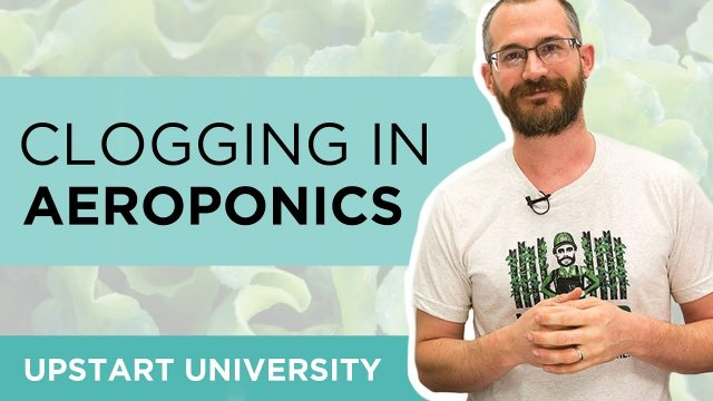 Why is clogging an issue in aeroponics?