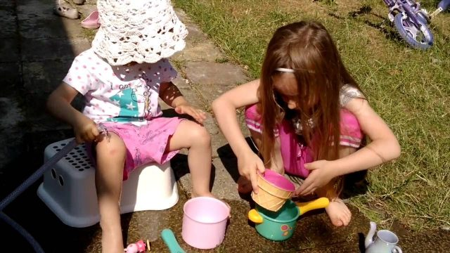 Water Activities For Kids-Playing with water in the garden